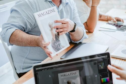 Creative people working on magazine cover design - 2012728