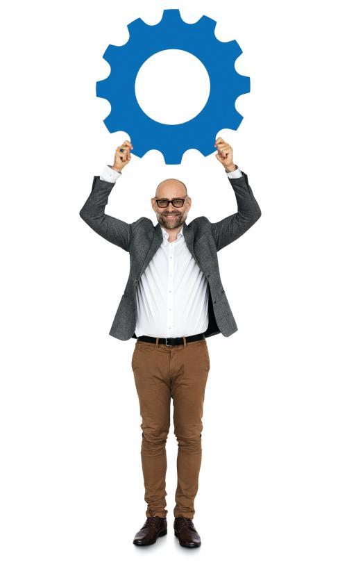 Businessman holding a cogwheel icon - 468182