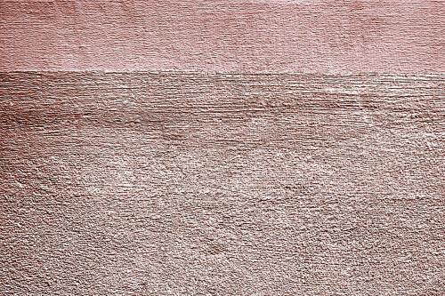 Roughly pink gold painted concrete wall surface background - 596847