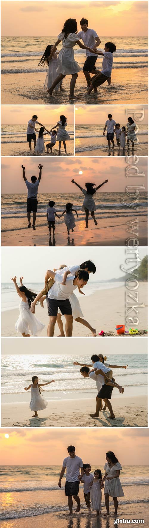 Happy family enjoy vacation on beach in evening