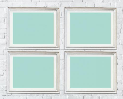 Four photo frames isolated on white wall - 328119