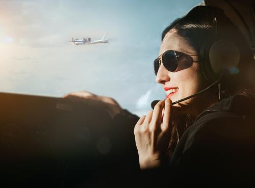 Aviator with headphones listening to the air traffic - 1202199
