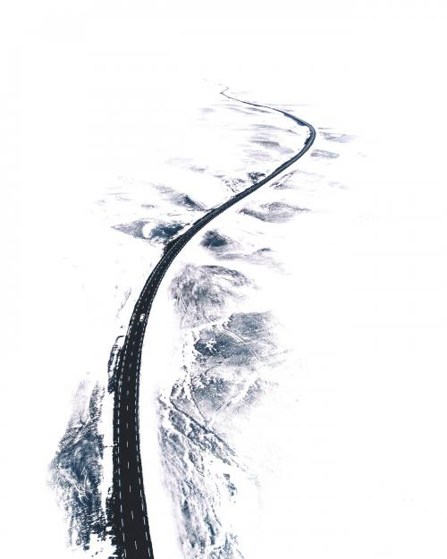 Curvy snow covered road in Northern Iceland - 1017130