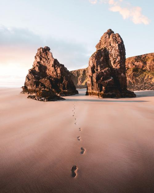 Footsteps on the sand passing through the outer Hebrides island, Scotland - 1017143