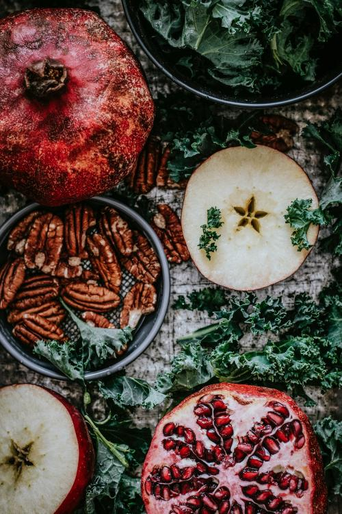 Fresh pomegranate with apples and pecans food photography - 1054333