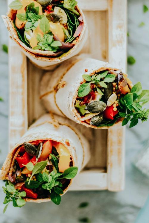 Tortilla wraps with roasted vegetables and mozzarella cheese food photography - 1054384