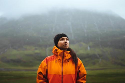 Woman in waterproof jacket while trekking in the highlands - 1077885