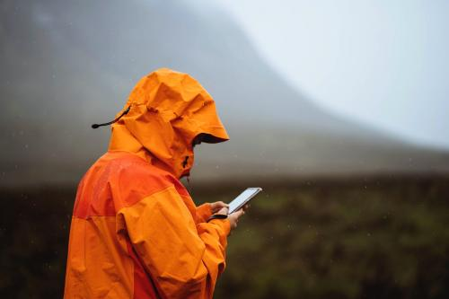 Woman using her mobile phone in the highlands - 1077924