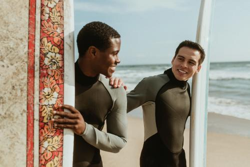 Happy surfers at the beach - 1079848
