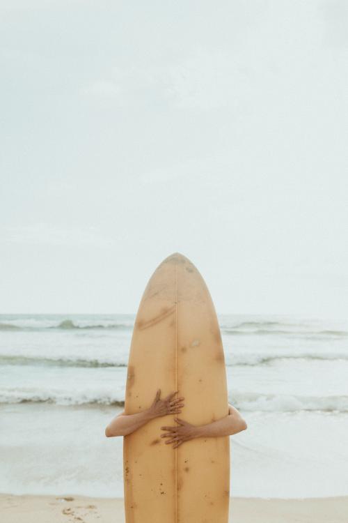 Surfer hugging a surfboard mockup - 1079857