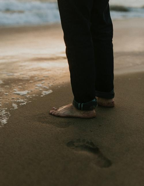 Man standing by the seaside - 1079876