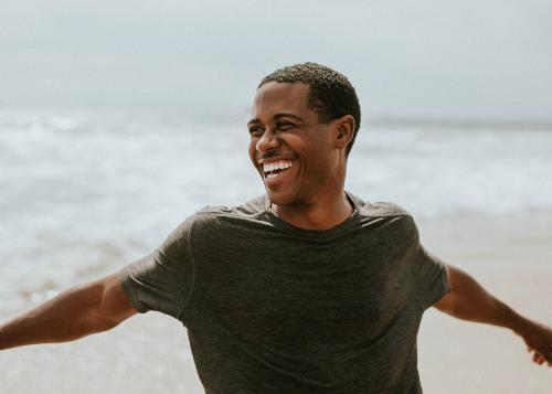 Cheerful man enjoying on the beach - 1079912