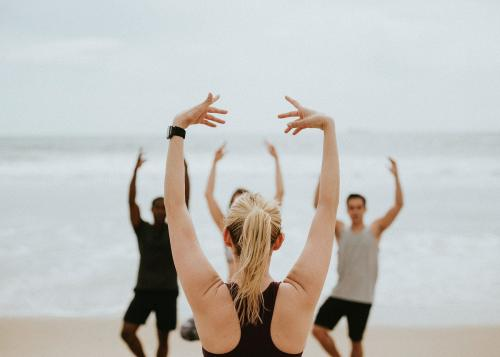 Athletic people stretching at the beach - 1079959