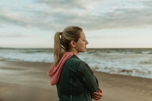 Woman on a gloomy beach - 1080017