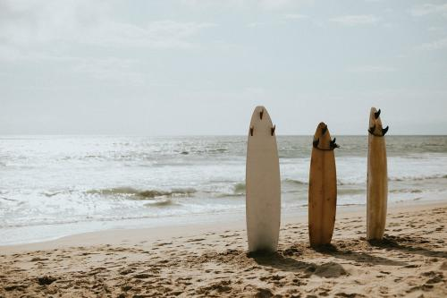 Surfboard mockup on the beach - 1080054