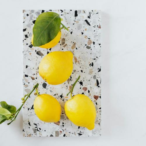 Fresh and organic lemons on a marble chopping board flatlay - 1198199