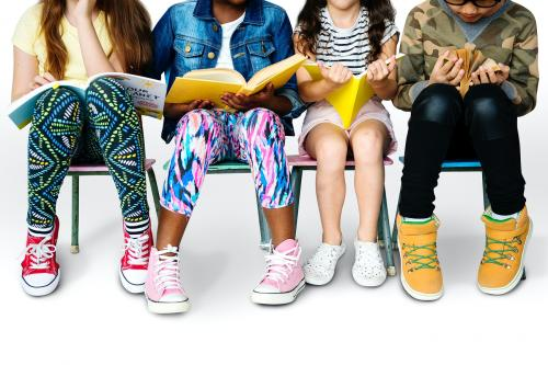 Group of students sitting and reading book - 7336