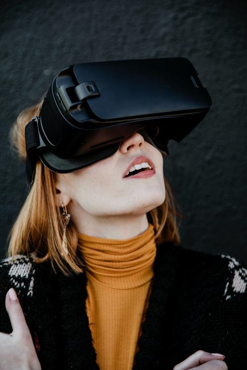 Woman enjoying a VR experience - 1198726