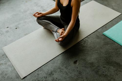 Woman meditating in a yoga class - 1201598
