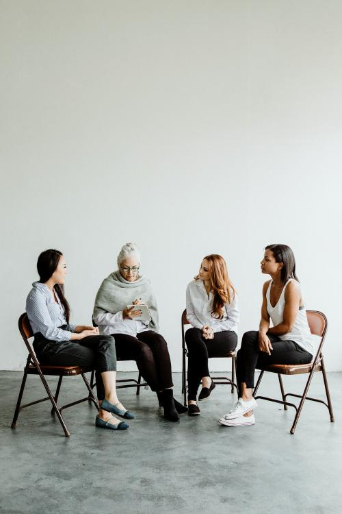 Diverse women in a supporting group session - 1201604