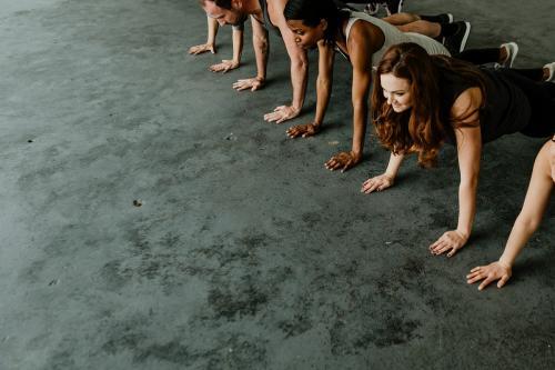 Diverse people practicing a Phalakasana pose - 1201656