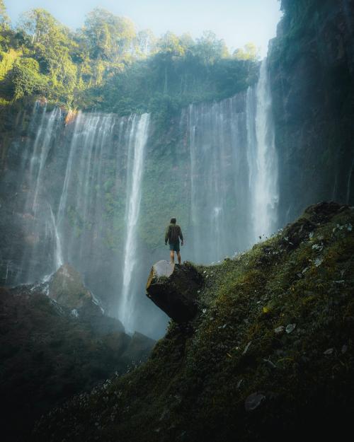 Man standing by Tumpak Sewu Waterfalls, Indonesia - 1204721