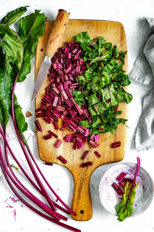 Chopped beetroot on a wooden board aerial view - 1204800