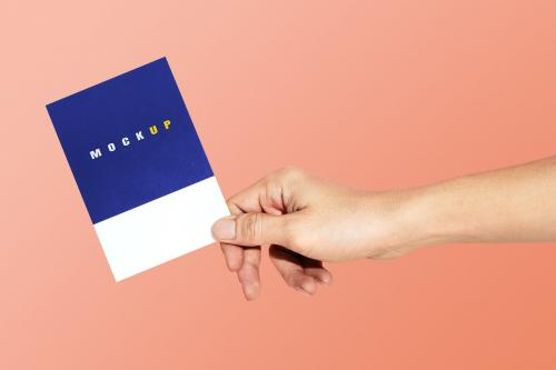 Hand holding a paper psd mockup - 2054371