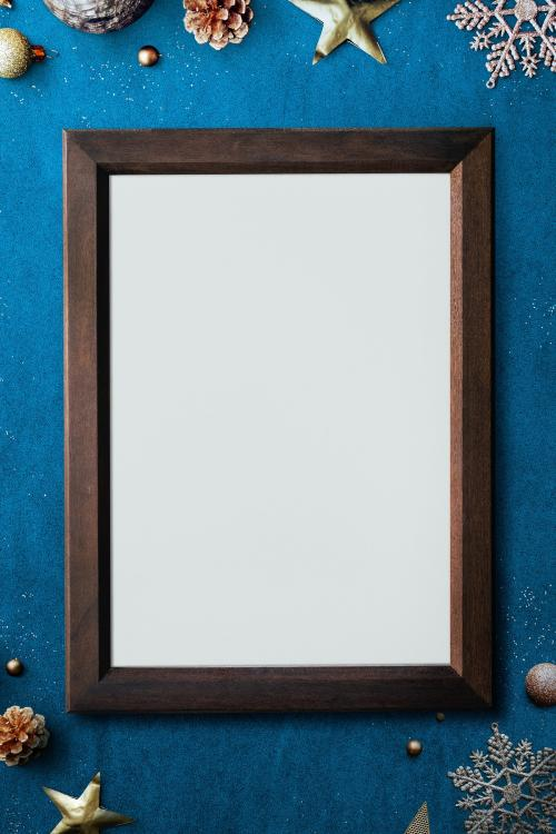 Wooden frame mockup with Christmas decorations on blue background - 1232335