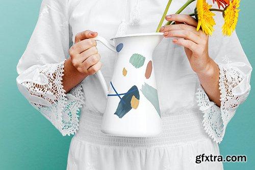 Girl holding a jug mockup with daisies 1210116