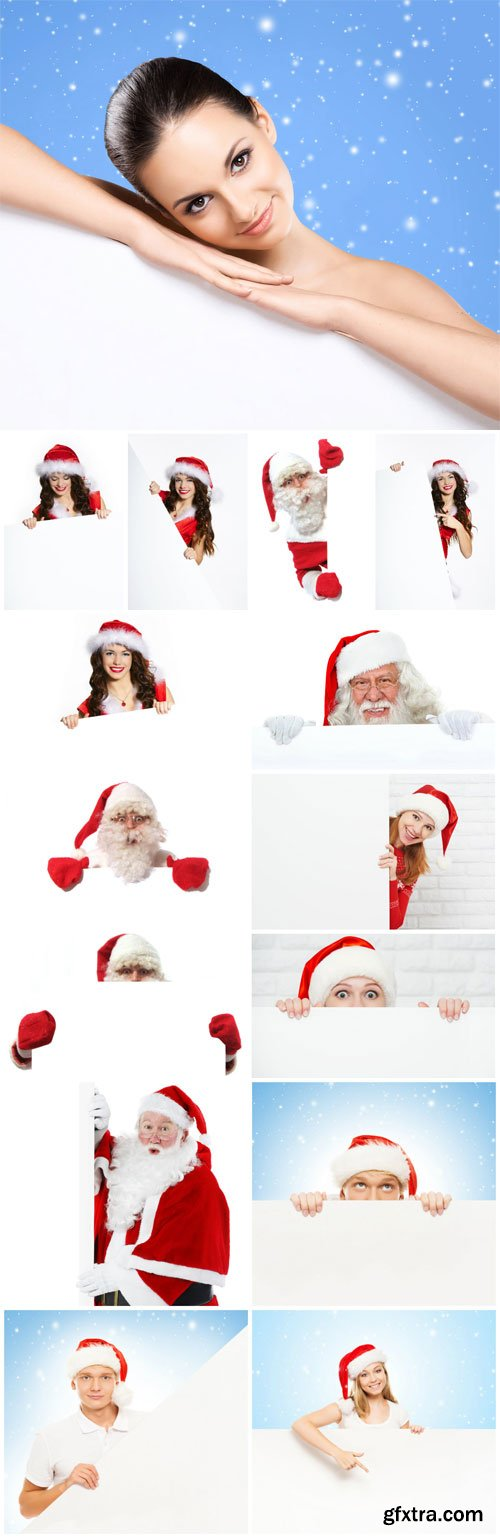 People in santa costumes holding posters stock photo
