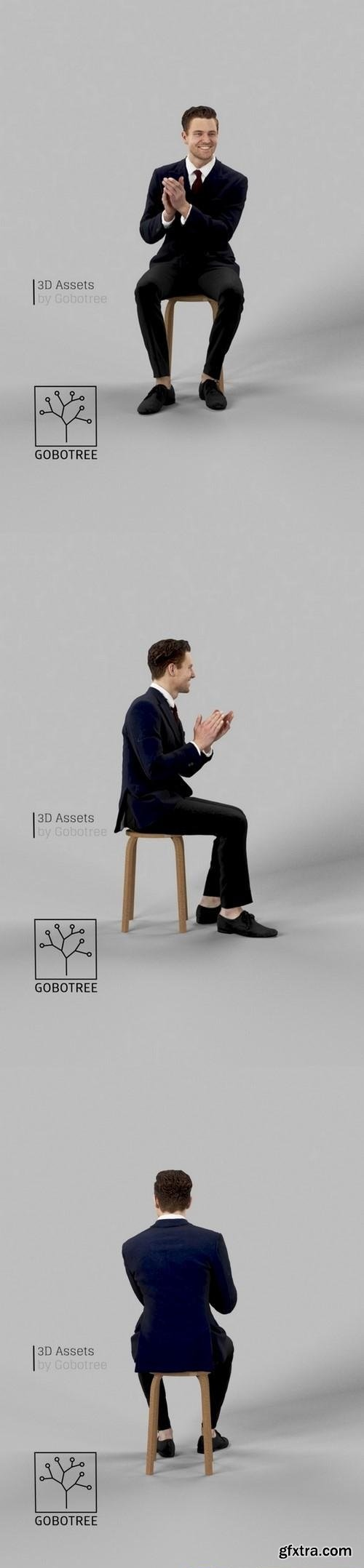 Business Man Sitting In A Black Suit Clapping