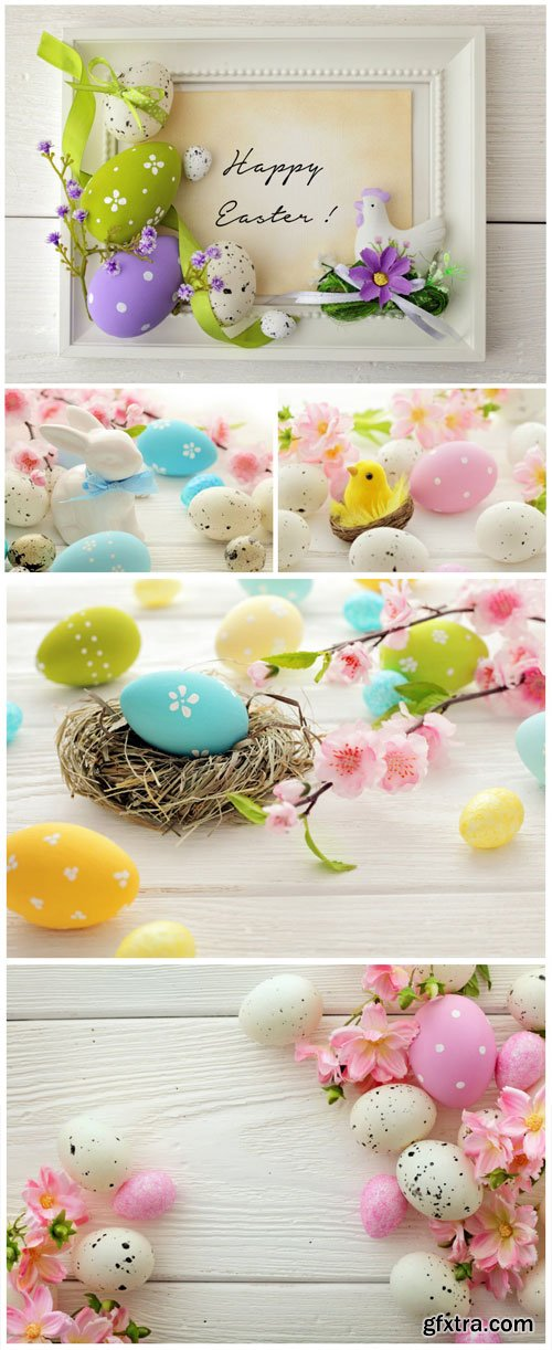 Easter eggs and flowers stock photo
