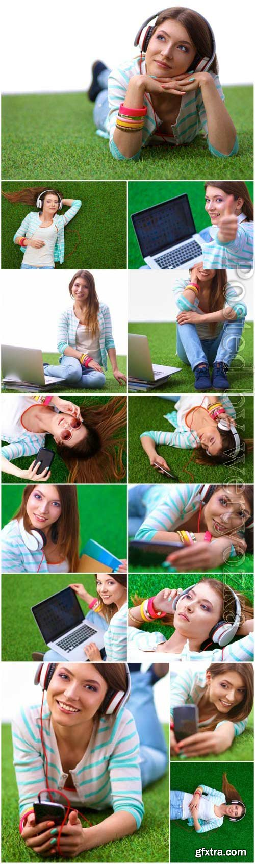 Girl with gadgets on green grass stock photo