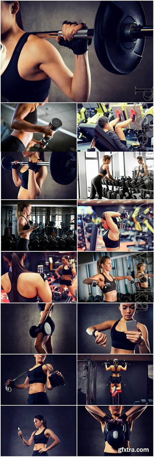 Girl with a beautiful figure in the gym stock photo