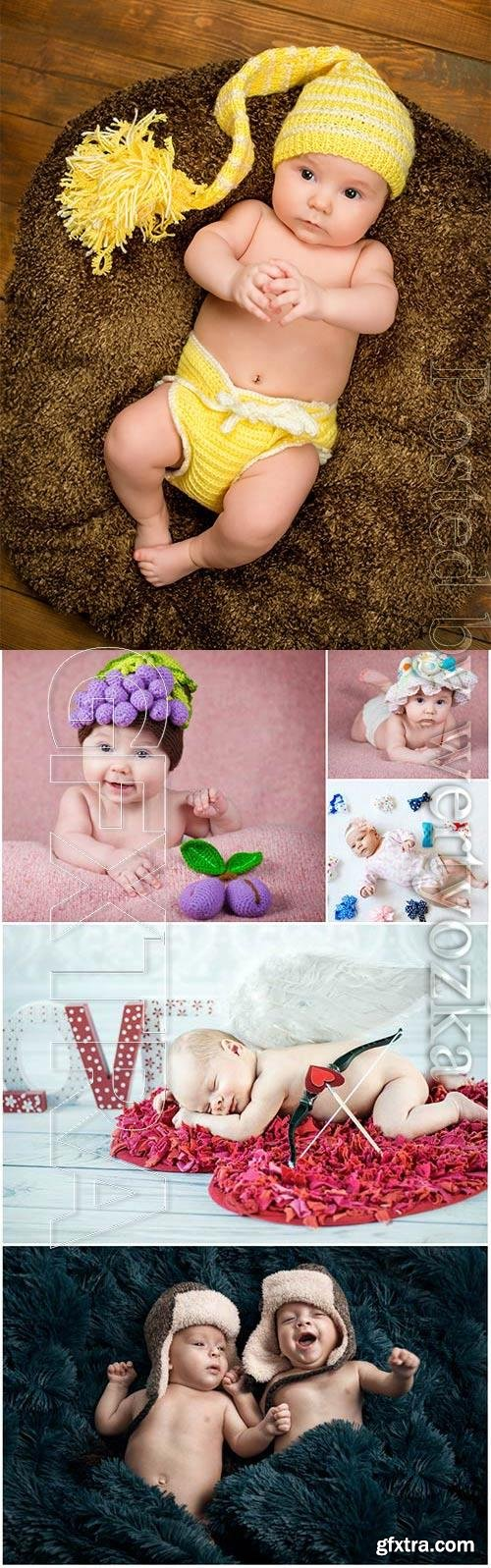 Cute little kids in funny hats stock photo