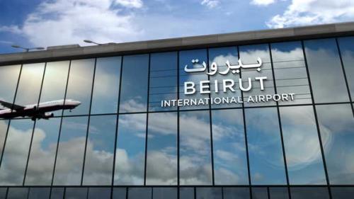Videohive - Airplane landing at Beirut Lebanon airport mirrored in terminal - 33848126 - 33848126