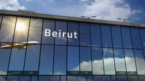 Videohive - Airplane landing at Beirut Lebanon airport mirrored in terminal - 33848128 - 33848128