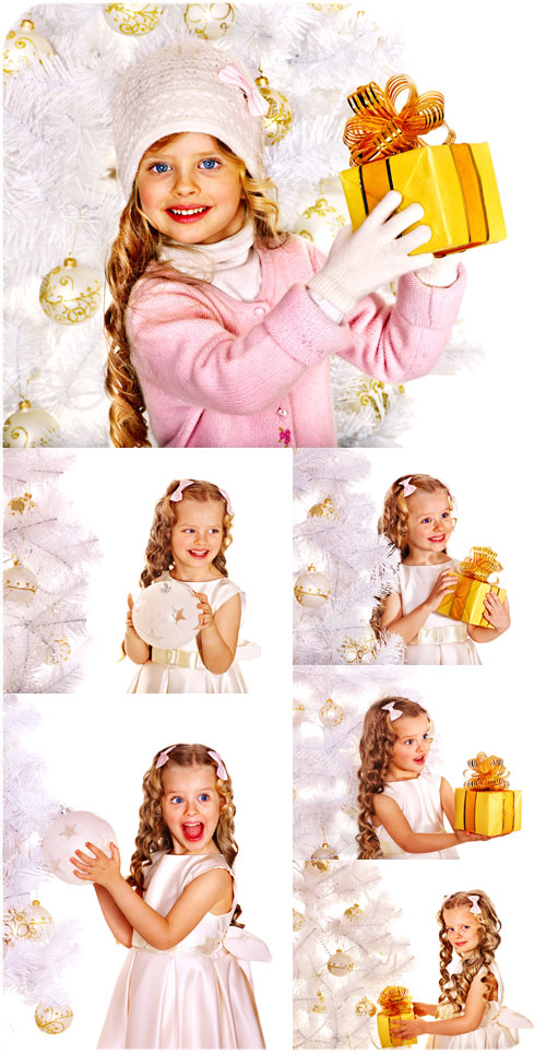 Little girl with golden curls at the Christmas tree - stock photo
